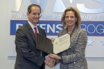 Phil Calbos accepts the Secretary's Appreciation Award from NNSA Administrator Lisa E. Gordon-Hagerty.