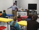 UCOR Deputy Waste Disposition Manager Clint Mori talks with students at Family Science Saturday about how he uses engineering solutions in his job.