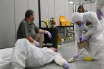 Hanford Site health physics technicians participate in radiological control technicians' training. The class offers interactive exercises like the decontamination demonstration shown here, which incorporates radiological work practice techniques.