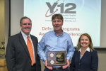 Brian Gullett, center, accepts his team's Award of Excellence from NNSA Assistant Deputy Administrator for Major Modernization Programs Michael Thompson and NNSA Production Office Deputy Manager Teresa Robbins.