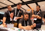 Students work on their wind turbines in their team booths at the Collegiate Wind Competition 2018, in Chicago on May 8, 2018.
