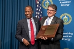 Secretary of Housing and Urban Development Ben Carson receives In Appreciation Award from Secretary of Energy Rick Perry