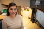 Megan Yachini at her desk