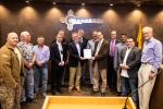 Carlsbad Field Office (CBFO) Manager Todd Shrader, center, right, and Nuclear Waste Partnership (NWP) President and Project Manager Bruce Covert hold a proclamation from Carlsbad Mayor Dale Janway, left of Covert, declaring March 26-April 26 as WIPP Appre