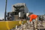 A Savannah River Remediation employee works outside the Actinide Removal Process in H Tank Farm.