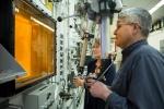 Radiochemical technicians David Denton and Karen Murphy use hot cell manipulators at Oak Ridge National Laboratory during the production of actinium-227.