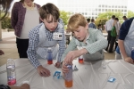 Children create lava lamps with oil, water, food coloring and sodium bicarbonate