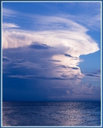 In areas with weak surface winds, additional evaporation from the ocean's surface is a major energy source for driving tropical patterns that create rainfall.