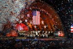 """Confetti rains down at the completion of the song """"Stars and Stripes Forever"""" during the Boston Pops Orchestra and Fireworks Spectacular."""