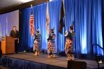 Photo of three women holding the U.S. flag.