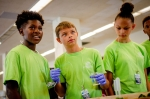 """Oscar Cross Club members (left to right) Jakevion """"DJ"""" Perry, Chris Moore, and Madison Moore participate in a hands-on activity about groundwater remediation."""