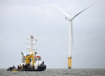 A boat sails near the Siemens' 3.6 MW Offshore Wind Turbine