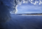 A photo of a wave breaking in the ocean.