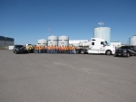 EM crews pose with Idaho State Police (ISP) officers in advance of the 500th shipment of transuranic waste leaving the Radioactive Waste Management Complex, headed for the Waste Isolation Pilot Plant. ISP officers inspect each shipment that leaves the DOE