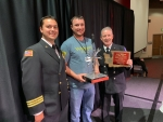 Mission Support Alliance fire mechanic Joshua Wright, center, receives the 2019 Washington State Fire Mechanic of the Year award. Also pictured are the Hanford Fire Department's deputy fire chief Adam Moldovan, left, and battalion chief Mark Cope.