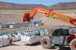 Crews place the final containers of waste into Cell 18 at the Area 5 Radioactive Waste Management Complex at the Nevada National Security Site.