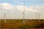 wind turbines against a blue sky.