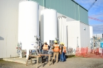 Hanford Waste Treatment and Immobilization Plant (WTP) workers inspect two bulk liquid argon storage tanks that are part of the liquid gas storage system at the WTP Analytical Laboratory. The system provides gases such as argon and nitrogen to equipment i