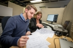 Science Undergraduate Laboratory Internship program participant Eric Rohm, left, and mentor Heather Gray