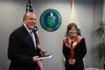 Under Secretary for Science Paul Dabbar and AITO Director Cheryl Ingstad share a light moment after her Swearing In Ceremony
