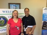 Amy Shumate pauses for a photograph with Four Rivers Nuclear Partnership Senior Community Relations Specialist and DOE community tour coordinator Steve Christmas before a recent tour.