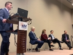 "EM managers tackled a variety of questions from the audience and moderator Martin Schneider of Longenecker and Associates (standing) during the ""Hot Topics"" panel at the Waste Management Symposia. Seated from left are Savannah River Site Manager Mike Budn"