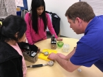 Mike Franklin, a field radiological engineer with UCOR, shows students how to use instrumentation to survey and detect radiation at the STEM event at Jefferson Middle School in Oak Ridge.