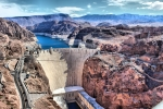 Water and Hoover dam against the mountains.