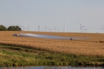 wind turbines in a field.