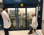 2 researchers looking at a ozone concentration in the pretreatment reactor