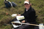 Colleen Iversen from Oak Ridge National Laboratory holds a soil core in the Alaskan tundra.