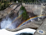 Photograph of Diablo Dam with a rainbow shining off of the flowing water.