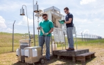 In this February 2020 photo, Savannah River Nuclear Solutions (SRNS) Scientist Jason Walker, left, inspects a new portable air monitoring station, while SRNS Environmental Specialist Jesse Baxley records readings from one of several permanent units at the