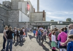 Students arrive at B Reactor for a tour. The Department of Energy works with elementary, middle, and high schools around the region to highlight B Reactor's role in ushering in the atomic age, and the importance of STEM education.