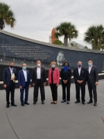 Energy leaders stand in front of Cape Canaveral.
