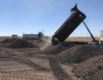 Following cover placement, the Materials and Fuels Complex Landfill was reseeded and mulched. In a few years, it will look like the surrounding terrain.