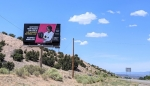 A billboard in Pojoaque along Highway 502 promotes the collaborative program between Northern New Mexico College and the Laboratory.