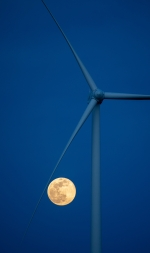 The Pink Supermoon rises near the National Renewable Energy Laboratory's Flatirons Campus wind turbine.