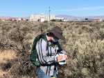 Archaeologist Lindsay Kiel with EM Richland Operations Office contractor Mission Support Alliance takes field notes during an archaeological survey on Hanford's Central Plateau.