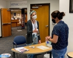 Audrey Wright, health educator for the Hanford medical services provider, conducts a brief health screening for a worker entering one of the site's occupational medical facilities.
