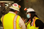Principal Deputy Assistant Secretary for Field Operations Nicole Nelson-Jean talks to Carlsbad Field Office Deputy (CBFO) Manager Ed Garza during a tour of the underground at the Waste Isolation Pilot Plant (