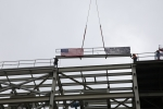 "The UPF Project places the last piece of structural steel on the Salvage and Accountability Building (SAB) during an Oct. 26 ""topping out"" ceremony."