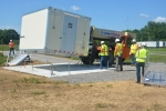 The first new air monitoring station is delivered to its installation location on Hewes Road at the Portsmouth Site.
