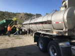 EM crews at Los Alamos National Laboratory empty purged well water into a truck for offsite disposal.
