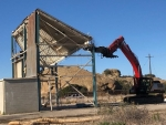 EM workers on Feb. 4 knocked down the 13th of 18 DOE-owned buildings at the former Energy Technology Engineering Center site.