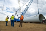 A work crew installs a turbine at National Renewable Energy Laboratory's Wind Technology Center in Colorado. The Advanced Technological Education program aims to strengthen and increase opportunities for clean energy-related training at community colleges throughout the country.   Photo by Dennis Schroeder, National Renewable Energy Laboratory