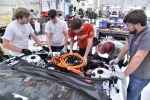 Members of Mississippi State University, one of of 16 EcoCAR competition teams, work on their redesign of the 2016 Chevrolet Camaro.
