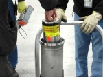 A container holding plutonium-bearing materials is placed inside an outer container. A number of these containers at SRS go through examinations each year to look for signs of degradation.