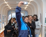 Roderick Jackson and a group of high schoolers pause for a selfie inside Oak Ridge National Lab's 3D-printed house. | Photo Courtesy of Oak Ridge National Lab.