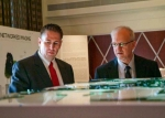 DOE-EM Senior Advisor Dave Huizenga, right, and DOE Paducah Site Lead Reinhard Knerr look at a three-dimensional model of the Paducah Site's groundwater system. University of Kentucky College of Design students assembled the model for the Paducah Citizens Advisory Board. The model was displayed at the Site-Specific Advisory Board Chairs Meeting in Paducah, where Huizenga spoke April 18.